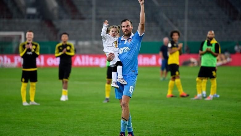 Reus, Alcácer send Dortmund through 2-0 in German Cup