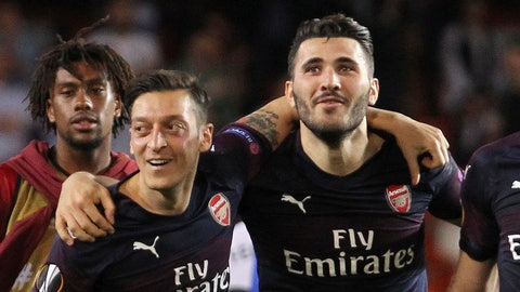 """<p>               FILE - In this Thursday, May 9, 2019 file photo, Arsenal defender Sead Kolasinac, right celebrates with Arsenal midfielder Mesut Ozil, left, at the end of the Europa League semifinal soccer match, second leg, between Valencia and Arsenal at the Camp de Mestalla stadium in Valencia, Spain. Arsenal says Mesut Ozil and Sead Kolasinac will not be in the squad for its Premier League season opener due to police investigating """"security incidents"""" two weeks after they fought off two knife-wielding men, it was reported on Friday, Aug. 9, 2019. (AP Photo/Alberto Saiz, File)             </p>"""
