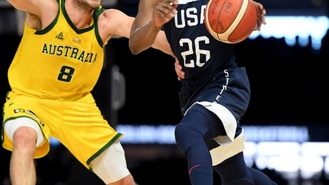 <p>               Australia's Matthew Dellavedova, left, and United States' Kemba Walker in action during their exhibition basketball game in Melbourne, Saturday, Aug. 24, 2019. (AP Photo/Andy Brownbill)             </p>