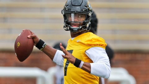 <p>               FILE - In this Aug. 12, 2019, file photo, Missouri quarterback Kelly Bryant throws during the NCAA college football team's practice in Columbia, Mo. Missouri plays at Wyoming this week. Bryant led Clemson to the 2017 national championship game before losing his job to Trevor Lawrence after four games last season. At Missouri, he'll be asked to replace Drew Lock, who accounted for 12,193 yards and 99 touchdowns over his career and led the Tigers to bowl games each of the past two years. (AP Photo/Jeff Roberson, File)             </p>