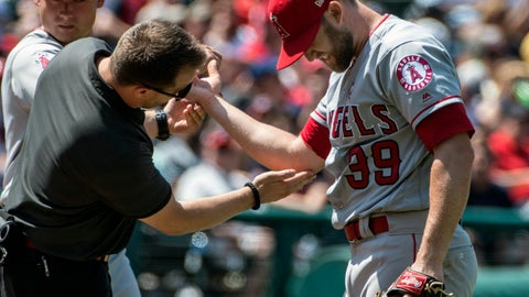 <p>               Los Angeles relief pitcher Luke Bard, right, is tended to by an unidentified trainer after being hit by a Cleveland Indians' Carlos Santana line drive during the fifth inning of a baseball game in Cleveland, Sunday, Aug. 4, 2019. (AP Photo/Phil Long)             </p>