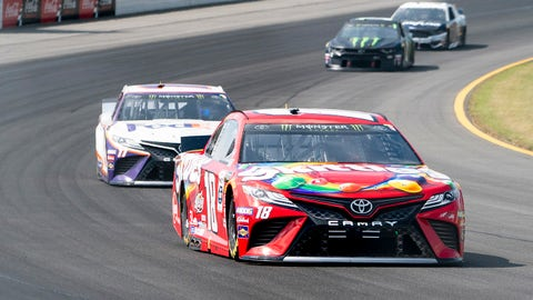 LONG POND, PA - JULY 28: Monster Energy NASCAR Cup Series driver Kyle Busch of the #18 Joe Gibbs Racing Toyota Camry races with Monster Energy NASCAR Cup Series driver Denny Hamlin of the #11 Joe Gibbs racing Toyota Camry following during the Monster Energy NASCAR Cup Series Gander Outdoors 400 on July 28, 2019 at Pocono Raceway in Long Pond, PA.(Photo by Gregory Fisher/Icon Sportswire via Getty Images)