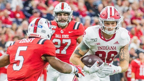 .Aug 31, 2019; Indianapolis, IN, USA; Indiana Hoosiers tight end Peyton Hendershot (86) runs the ball after a catch while Ball State Cardinals safety Bryce Cosby (5) defends in the second half of the game at Lucas Oil Stadium. Mandatory Credit: Trevor Ruszkowski-USA TODAY Sports
