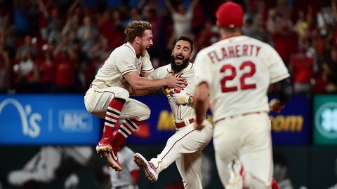 Aug 31, 2019; St. Louis, MO, USA; St. Louis Cardinals pinch hitter Matt Carpenter (13) celebrates with center fielder Harrison Bader (48) after hitting a walk off one run single off of Cincinnati Reds starting pitcher Kevin Gausman (not pictured) during the ninth inning at Busch Stadium. Mandatory Credit: Jeff Curry-USA TODAY Sports