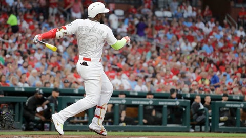 St. Louis Cardinals' Marcell Ozuna watches his two-run home run during the first inning of the team's baseball game against the Colorado Rockies on Friday, Aug. 23, 2019, in St. Louis. (AP Photo/Jeff Roberson)