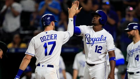 Kansas City Royals' Hunter Dozier (17) is congratulated by Jorge Soler (12) after his two-run home run during the third inning of the team's baseball game against the Oakland Athletics at Kauffman Stadium in Kansas City, Mo., Wednesday, Aug. 28, 2019. (AP Photo/Orlin Wagner)