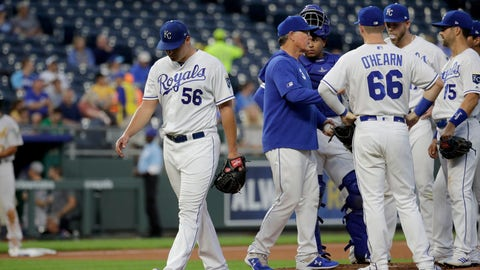 Kansas City Royals starting pitcher Brad Keller (56) comes out of a baseball game during the second inning against the Oakland Athletics Monday, Aug. 26, 2019, in Kansas City, Mo. (AP Photo/Charlie Riedel)