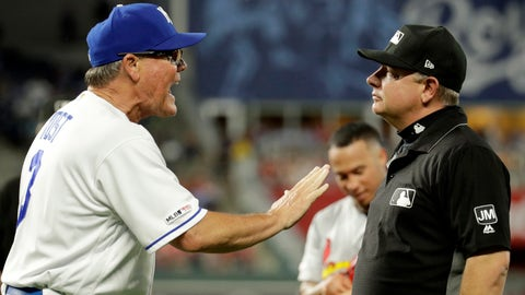Kansas City Royals manager Ned Yost talks with first base umpire Greg Gibson after being ejected from the game during the fifth inning of a baseball game against the St. Louis Cardinals Tuesday, Aug. 13, 2019, in Kansas City, Mo. (AP Photo/Charlie Riedel)