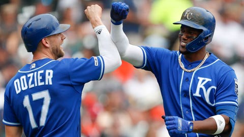 Aug 11, 2019; Detroit, MI, USA; Kansas City Royals designated hitter Jorge Soler (12) celebrates with third baseman Hunter Dozier (17) after hitting a two run home run against the Detroit Tigers during the third inning at Comerica Park. Mandatory Credit: Raj Mehta-USA TODAY Sports
