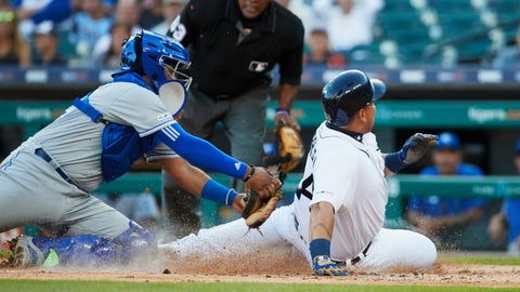 Aug 9, 2019; Detroit, MI, USA; Detroit Tigers designated hitter Miguel Cabrera (24) slides in safe at home ahead of the tag by Kansas City Royals catcher Meibrys Viloria (72) in the first inning at Comerica Park. Mandatory Credit: Rick Osentoski-USA TODAY Sports