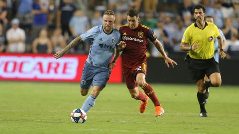 Aug 10, 2019; Kansas City, KS, USA; Sporting Kansas City forward Johnny Russell (7) and Real Salt Lake defender Aaron Herrera (22) fight for the ball during a match at Children's Mercy Park. Mandatory Credit: Scott Sewell-USA TODAY Sports