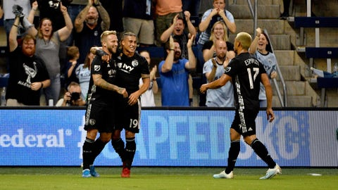 Aug 31, 2019; Kansas City, KS, USA; Sporting Kansas City forward Johnny Russell (7) is congratulated by forward Erik Hurtado (19) and midfielder Roger Espinoza (17) after scoring against the Houston Dynamo during the first half at Children's Mercy Park. Mandatory Credit: Denny Medley-USA TODAY Sports