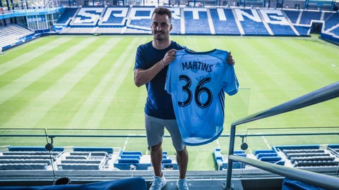 Luis Martins shows off his new jersey at Children's Mercy Park after signing with Sporting Kansas City on August 1, 2019.