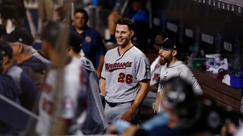 Minnesota Twins' Max Kepler (26) celebrates in the dugout after hitting a solo home run during the first inning of a baseball game against the Miami Marlins on Thursday, Aug. 1, 2019, in Miami. (AP Photo/Brynn Anderson)