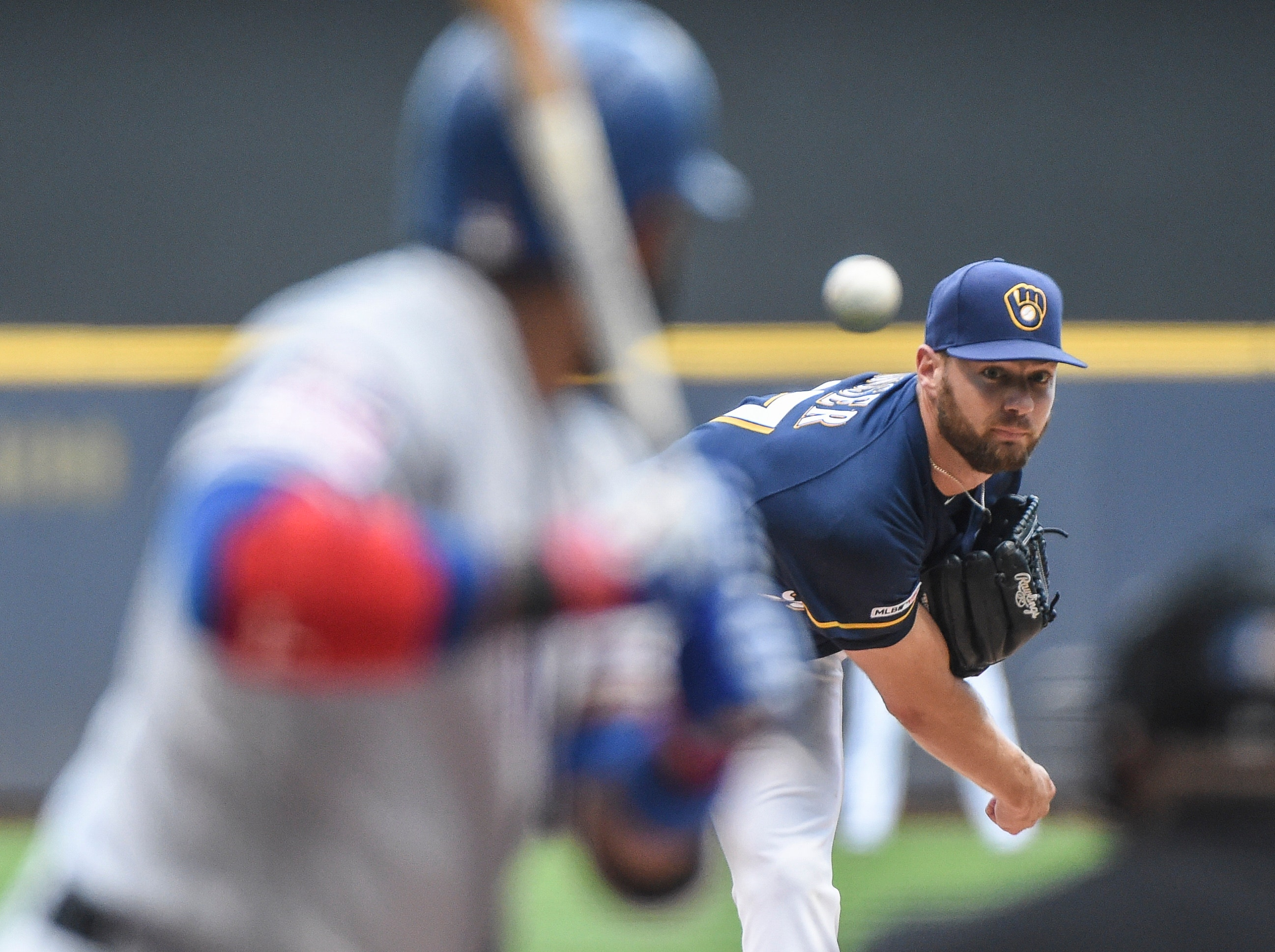 Houser strikes out 10, Brewers beat Rangers 3-2 for 5th straight