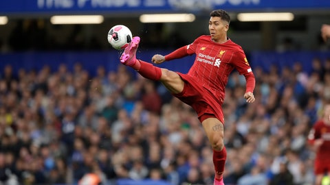 <p>               Liverpool's Roberto Firmino reaches for the ball during the British premier League soccer match between Chelsea and Liverpool, at the Stamford Bridge Stadium, London, Sunday, Sept. 22, 2019. (AP Photo/Matt Dunham)             </p>