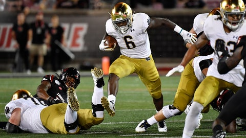 <p>               Notre Dame running back Tony Jones Jr. (6) runs through an opening in the Louisville defensive line during the first half of an NCAA college football game against Louisville in Louisville, Ky., Monday, Sept. 2, 2019. (AP Photo/Timothy D. Easley)             </p>
