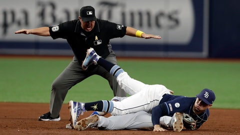 <p>               Tampa Bay Rays shortstop Willy Adames lands on top of Toronto Blue Jays' Jonathan Davis, bottom, after Davis stole second base during the sixth inning of a baseball game Saturday, Sept. 7, 2019, in St. Petersburg, Fla. Doug Eddings, top, makes the call. (AP Photo/Chris O'Meara)             </p>
