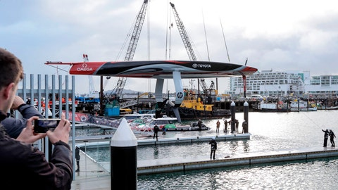 <p>               America's Cup defending champions Team New Zealand lowers its revolutionary foiling mono-hull sailboat into the water at its official launch at the Viaduct Basin in Auckland, New Zealand, Friday Sept. 6, 2019. Auckland will host the 36th America's Cup in 2021. (Michael Craig/NZ Herald via AP)             </p>