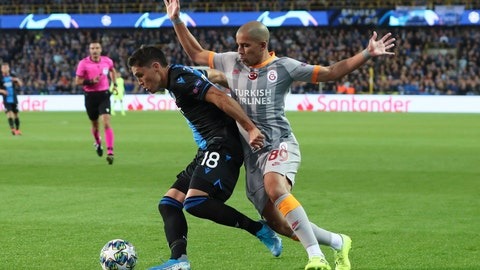 <p>               Brugge's Federico Ricca, left, is challenged by Galatasaray's Sofiane Feghouli during the Champions League group A soccer match between Club Brugge and Galatasaray at the Jan Breydel stadium in Bruges, Belgium, Wednesday, Sept. 18, 2019. (AP Photo/Francisco Seco)             </p>