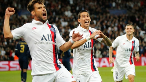 <p>               PSG's Angel Di Maria, center, celebrates with his teammates PSG's Juan Bernat, left, and PSG's Mauro Icardi after scoring his side's opening goal during the Champions League group A soccer match between PSG and Real Madrid at the Parc des Princes stadium in Paris, Wednesday, Sept. 18, 2019. (AP Photo/Francois Mori)             </p>
