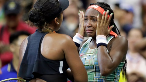 <p>               Coco Gauff wipes away tears while talking to Naomi Osaka, of Japan, after Osaka defeated Gauff during the third round of the U.S. Open tennis tournament Saturday, Aug. 31, 2019, in New York. (AP Photo/Adam Hunger)             </p>