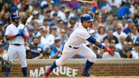 <p>               Chicago Cubs' Javier Baez hits a single during the sixth inning of a baseball game against the Milwaukee Brewers, Saturday, Aug 31, 2019, in Chicago. Milwaukee won 2-0. (AP Photo/Paul Beaty)             </p>