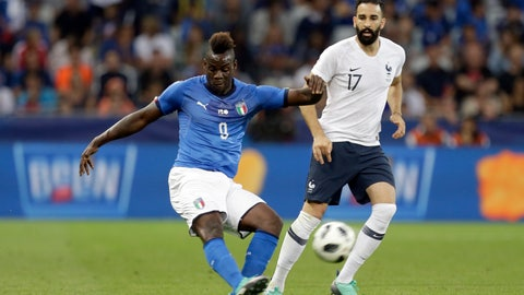 <p>               FILE -  In this Friday, June 1, 2018 file photo, Italy's Mario Balotelli, left, kicks the ball while France's Edil Rami looks on during a friendly soccer match between France and Italy at the Allianz Riviera stadium in Nice, southern France. Italy coach Roberto Mancini has set the bar high for Mario Balotelli's chances of returning to the national team. Balotelli recently returned to Serie A with Brescia, his hometown club, but his season hasn't started yet as he serves a four-match ban following a straight red card in his final game for Marseille against Montpellier in May. (AP Photo/Claude Paris, File)             </p>