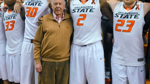 <p>               FILE - In this March 2, 2013, file photo, oil tycoon and Oklahoma State supporter T. Boone Pickens, center, celebrates with Oklahoma State's basketball team members Marcus Smart (33), Mason Cox (30), Le'Bryan Nash (2) and Alex Budke, right, following the team's win over Texas in an NCAA college basketball game in Stillwater, Okla. Pickens, a brash and quotable oil tycoon who grew even wealthier through corporate takeover attempts, died Wednesday, Sept. 11, 2019. He was 91. (AP Photo/Brody Schmidt, File)             </p>