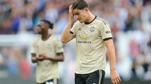 <p>               Manchester United's Harry Maguire touches his forehead as he leaves at the end of the English Premier League soccer match between West Ham and Manchester United at London stadium in London, Sunday, Sept. 22, 2019. West Ham beat Manchester United 2-0. (AP Photo/Leila Coker)             </p>