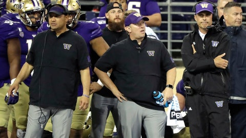 <p>               Washington head coach Chris Petersen, right, stands with other members of his staff late in the second half of an NCAA college football game in the early hours of Sunday, Sept. 8, 2019, in Seattle. California won 20-19. (AP Photo/Ted S. Warren)             </p>