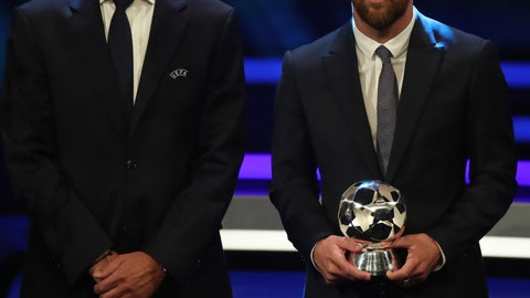 <p>               Barcelona's soccer player Lionel Messi, right, holds the award of UEFA Champions League forward of the season 2018/19 as he poses with UEFA President Aleksander Ceferin during the group stage draw at the Grimaldi Forum, in Monaco, Thursday, Aug. 29, 2019. (AP Photo/Daniel Cole)             </p>