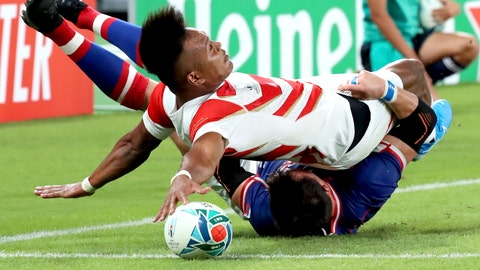 <p>               In this Friday, Sept. 20, 2019, file photo,  Japan's Kotaro Matsushima, top, makes an attempt to score a try, tackled by Russia's Vasily Artemyev during the Rugby World Cup Pool A game at Tokyo Stadium between Russia and Japan in Tokyo. The try was disallowed by video referee. (AP Photo/Eugene Hoshiko, File)             </p>