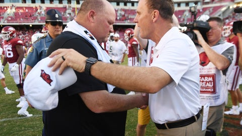 <p>               Arkansas coach Chad Morris, right, and Portland State coach Bruce Barnum shake hands following Arkansas' 20-13 win in an NCAA college football game Saturday, Aug. 31, 2019, in Fayetteville, Ark. (AP Photo/Michael Woods)             </p>
