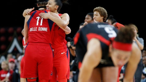 <p>               Washington Mystics' Elena Delle Donne, left, and Aerial Powers celebrate after defeating the Las Vegas Aces in Game 4 of a WNBA playoff basketball series Tuesday, Sept. 24, 2019, in Las Vegas. (AP Photo/John Locher)             </p>