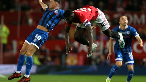 <p>               Rochdale's Ian Henderson, left, and Manchester United's Axel Tuanzebe battle for the ball during their English League Cup, Third Round soccer match at Old Trafford, Manchester, England, Wednesday, Sept. 25, 2019. (Richard Sellers/PA via AP)             </p>