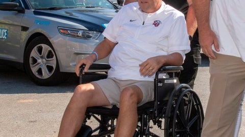 <p>               Liberty head football coach Hugh Freeze arrives to coach from a wheelchair in the coaches' box against Syracuse in an NCAA college football game in Lynchburg, Va., Saturday, Aug. 31, 2019. (AP Photo/Matt Bell)             </p>