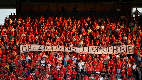 "<p>               FILE - In this Saturday, Aug. 31, 2019 file photo, Nimes fans hold up a banner that reads ""with us no homophobia"" before the start of the French League One soccer match between Nimes and Brest at the Stade des Costieres in Nimes, southern France. Referees should no longer stop matches when there is homophobic chanting, urged French Football Federation president Noël Le Graët. (AP Photo/Daniel Cole, File)             </p>"