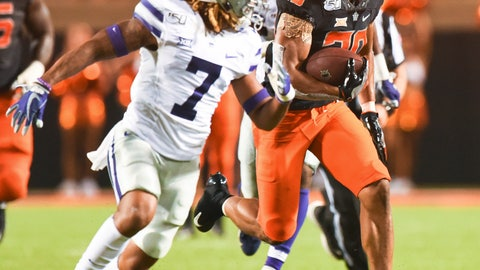 <p>               Oklahoma State running back Chuba Hubbard (30) looks to Kansas State defensive back Kevion McGee (7), while breaking free for a 84 yard run during the third quarter of an NCAA college football game in Stillwater, Okla., Saturday, Sept. 28, 2019. Hubbard led Oklahoma State rushing with 296 yards in the 26-13 win over Kansas State. (AP Photo/Brody Schmidt)             </p>