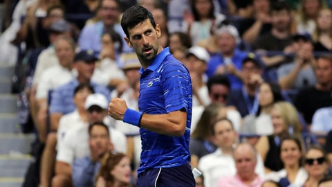 <p>               Novak Djokovic, of Serbia, pumps his fist as he looks back toward his coach after winning a point against Denis Kudla during the third round of the U.S. Open tennis tournament Friday, Aug. 30, 2019, in New York. (AP Photo/Charles Krupa)             </p>