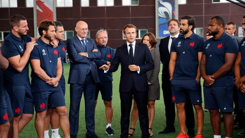 <p>               France's President Emmanuel Macron, center, speaks to French national rugby team players ahead of the upcoming Rugby Wcup, at the National Rugby Center in Marcoussis, south of Paris, Thursday, Sept.5, 2019. The French rugby team is preparing for the upcoming 2019 World Cup in Japan. (AP Photo/Christophe Ena, Pool)             </p>