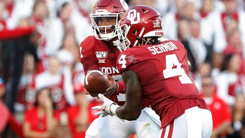 <p>               Oklahoma quarterback Jalen Hurts (1) hands the ball off to Oklahoma running back Trey Sermon (4) against Houston during the first half of an NCAA college football game in Norman, Okla., Sunday, Sept. 1, 2019. (AP Photo/Alonzo Adams)             </p>