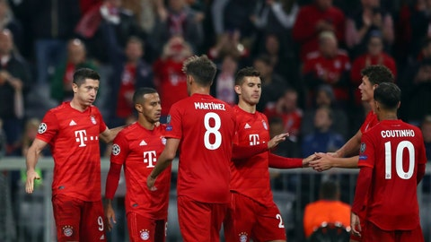 <p>               Bayern's Robert Lewandowski, left, celebrates with teammates after scoring his side's second goal during the Champions League group B first round soccer match between FC Bayern Munich and Red Star Belgrade, in Munich, Germany, Wednesday, Sept. 18, 2019. (AP Photo/Matthias Schrader)             </p>