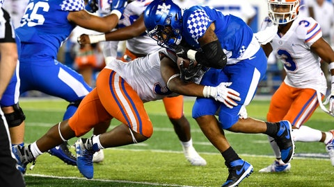 <p>               Kentucky running back Asim Rose, front right, is hit by Florida linebacker David Reese II (33) during the second half of an NCAA college football game in Lexington, Ky., Saturday, Sept. 14, 2019. (AP Photo/Timothy D. Easley)             </p>