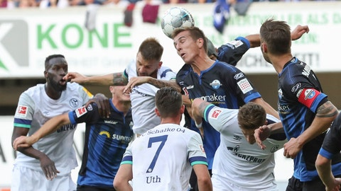 <p>               Paderborn's Uwe Hunemeier, center right, heads the ball in front of Schalke's Guido Burgstaller, center left, during the German Bundesliga soccer match between SC Paderborn 07 and FC Schalke 04 in the Benteler-Arena in Paderborn, Germany, Sunday Sept. 15, 2019. (Friso Gentsch/dpa via AP)             </p>