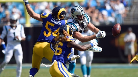 <p>               Carolina Panthers tight end Greg Olsen (88) reaches for a pass against Los Angeles Rams linebacker Bryce Hager (54) and defensive back Marqui Christian (26) during the second half of an NFL football game in Charlotte, N.C., Sunday, Sept. 8, 2019. (AP Photo/Mike McCarn)             </p>