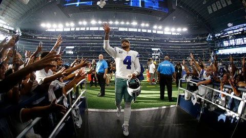 <p>               Dallas Cowboys' Dak Prescott (4) tosses a item to fans as he walks into the team tunnel after their NFL football game against the New York Giants in Arlington, Texas, Sunday, Sept. 8, 2019. The Cowboys won 35-17. (AP Photo/Ron Jenkins)             </p>