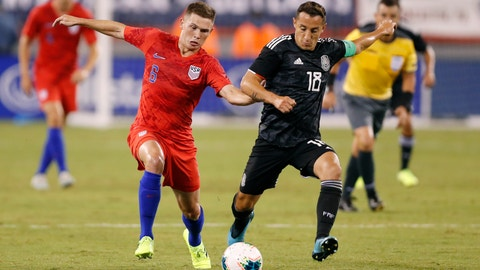 <p>               Mexico midfielder Andres Guardado (18) defends against U.S. midfielder Wil Trapp (6) during the first half of an international friendly soccer match Friday, Sept. 6, 2019, in East Rutherford, N.J. (AP Photo/Kathy Willens)             </p>