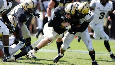 <p>               Purdue quarterback Elijah Sindelar (2) is tackled after a run by Vanderbilt safety Dashaun Jerkins (33) during the second half of an NCAA college football game in West Lafayette, Ind., Saturday, Sept. 7, 2019. Purdue defeated Vanderbilt 42-24. (AP Photo/Michael Conroy)             </p>