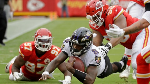 <p>               Baltimore Ravens quarterback Lamar Jackson (8) is tackled by Kansas City Chiefs defensive end Alex Okafor (97) and defensive tackle Xavier Williams, right, during the first half of an NFL football game in Kansas City, Mo., Sunday, Sept. 22, 2019. (AP Photo/Charlie Riedel)             </p>